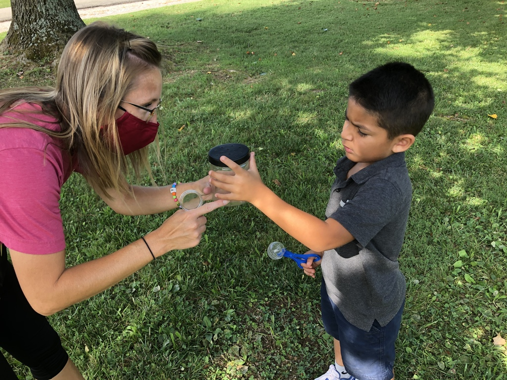 Mrs. Stites and student catching and observing insects during Summer School.